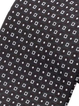 Черный мужской галстук с геометрическим узором. Галстук шириной 9 см у основания.