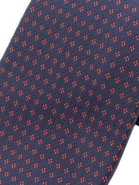 Темно-синий мужской галстук с бордовым узором. Галстук шириной 9 см у основания.