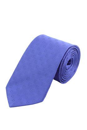 Ярко-синий однотонный мужской галстук с геометрическим узором. Галстук шириной 9 см у основания.